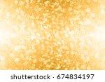 abstract gold glitter sparkle... | Shutterstock . vector #674834197