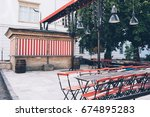 closed street cafe  old tables... | Shutterstock . vector #674895283