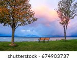 a bench and colorful skies over ...   Shutterstock . vector #674903737