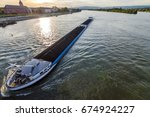 cargo ship with coal bulk load...   Shutterstock . vector #674924227