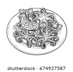 octopus with lemon on a plate.... | Shutterstock .eps vector #674927587