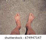 two legs on concrete floor | Shutterstock . vector #674947147