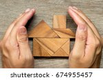 hands hold the tangram puzzle... | Shutterstock . vector #674955457