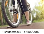 sporty woman on the bicycle... | Shutterstock . vector #675002083