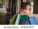 happy woman hugging her friend... | Shutterstock . vector #675031927
