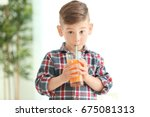 cute little boy drinking juice... | Shutterstock . vector #675081313