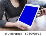 woman hand holding mobile phone ... | Shutterstock . vector #675090913