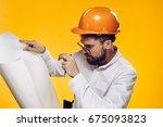 engineer in a helmet  drawing   ... | Shutterstock . vector #675093823