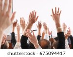 raised hands and arms of large... | Shutterstock . vector #675094417