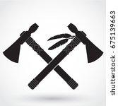 two silhouette crossed tomahawk ...   Shutterstock .eps vector #675139663