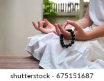 black beads bracelet in girl... | Shutterstock . vector #675151687