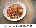 seafood spaghetti on white dish. | Shutterstock . vector #675163957