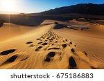 hiker in sand desert. sunrise... | Shutterstock . vector #675186883