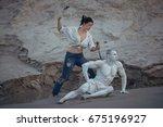 woman carves a sculpture of a... | Shutterstock . vector #675196927