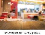 empty dark wooden table in... | Shutterstock . vector #675214513