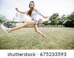 young woman tourist having fun... | Shutterstock . vector #675233593