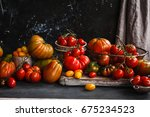 heirloom variety tomatoes on... | Shutterstock . vector #675234523