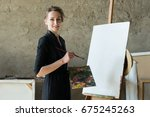 female artist with paintbrushes ... | Shutterstock . vector #675245263