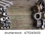tools and old auto parts on... | Shutterstock . vector #675265633