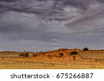 the beautiful red sand dunes of ... | Shutterstock . vector #675266887