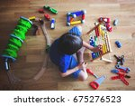 preschool child  playing with... | Shutterstock . vector #675276523