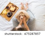 young woman with her dog in a... | Shutterstock . vector #675287857