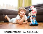 little boy playing with robot... | Shutterstock . vector #675316837