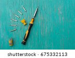 screwdriver set on wood... | Shutterstock . vector #675332113