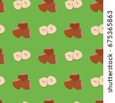 hazelnuts seamless background ...   Shutterstock .eps vector #675365863