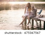 smiling mother and daughter... | Shutterstock . vector #675367567