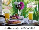 fresh fruit plates in paradise. ...   Shutterstock . vector #675368443
