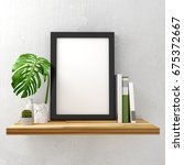 black photo frame mock up on a... | Shutterstock . vector #675372667