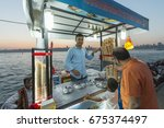 street ta ice cream seller in... | Shutterstock . vector #675374497