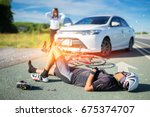 unconscious male cyclist lying... | Shutterstock . vector #675374707