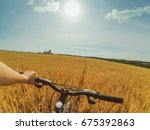 a man holds a wheel with one... | Shutterstock . vector #675392863