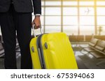 businessman and suitcase in the ... | Shutterstock . vector #675394063