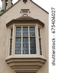 Small photo of Bay window with heraldic crest. Bay window featuring a heraldic crest from an English almshouse.