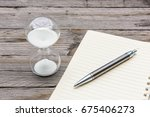 notebook  pencil and hourglass... | Shutterstock . vector #675406273