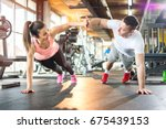 young sporty couple working out ... | Shutterstock . vector #675439153