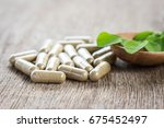 herbal capsules with moringa... | Shutterstock . vector #675452497