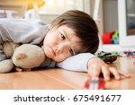 unhappy face of toddler boy... | Shutterstock . vector #675491677
