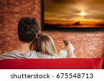 smart tv and young couple... | Shutterstock . vector #675548713