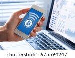 person sending bitcoin with... | Shutterstock . vector #675594247