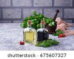 olive oil and vinegar in glass... | Shutterstock . vector #675607327