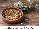 coconut granola in wooden bowl... | Shutterstock . vector #675655777