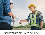 the evening sun with engineer... | Shutterstock . vector #675684793