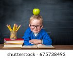 happy cute clever boy is... | Shutterstock . vector #675738493