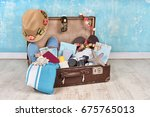 vintage suitcase with travel... | Shutterstock . vector #675765013