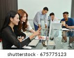 teamwork of asian business... | Shutterstock . vector #675775123