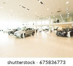 blurred dealership store  with...
